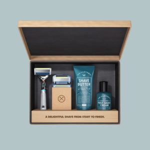Image of Dollar Shave Club wooden box with shaving products inside