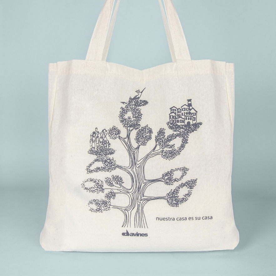Image of Davines beige tote bag with tree design on front